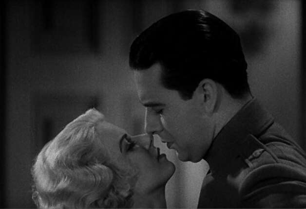 "Jean Harlow and Ben Lyon in ""Hell's Angels"" -- she has just slipped into ""something more comfortable.""  That's where the phrase comes from -- this scene. (HO / REUTERS)"