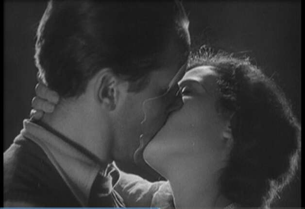 "The classic kiss from ""Ecstasy"" (1933) -- note how Hedy Lamarr's face is moving into his. (HO / REUTERS)"