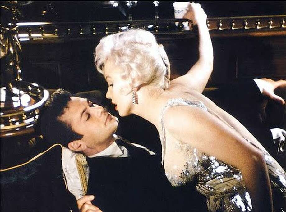 """Some Like It Hot"" -- Tony Curtis maintaining his composure under extreme pressure, opposite Marilyn Monroe."