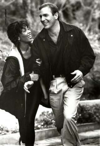 "Whitney Houston (with Kevin Costner) in ""The Bodyguard, "" 1992. 