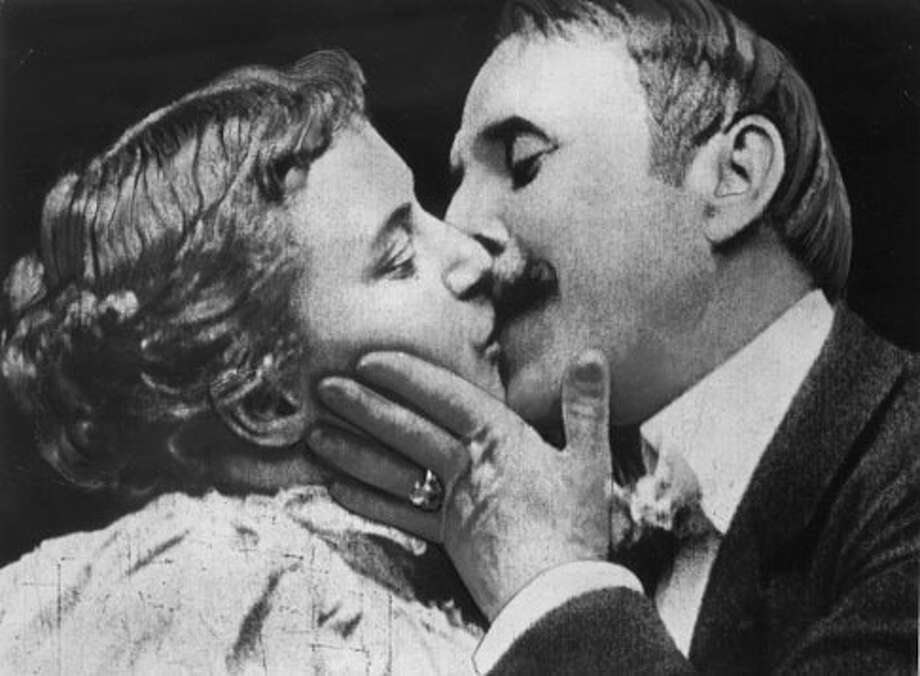 """The Kiss"" -- not the cutest people going, but they got things started in 1896 -- stage performers, re-enacting the end of their Broadway show, in a 30-second film that had everyone talking."