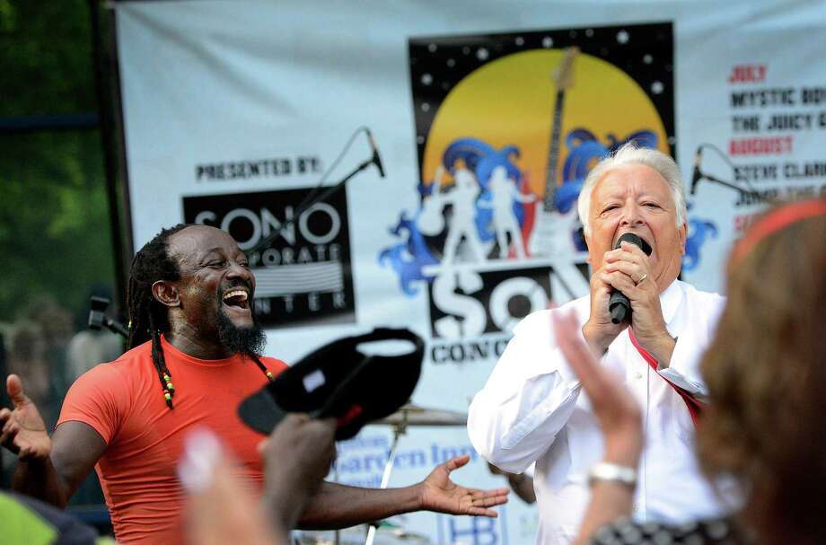 "Norwalk mayor Richard Moccia entertains the crowd by singing ""Sweet Caroline"" with the help of Mystic Bowie and his band at the SoNo Charity Concert series at 50 Washington Street, Norwalk Ct. Thursday July 12th, 2012. Photo: Mark Conrad / Connecticut Post Freelance"