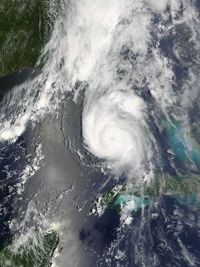 The MODIS sensor aboard NASA's Terra satellite captured this true-color image of Hurricane Charley on August 13 at 12:35 p.m. EDT. At the time this image was taken Charley was rapidly gaining strength and would reach category 4 status just 90 minutes later. Maximum sustained winds at 2:00 p.m. were at 145 mph and Charley was moving towards the north-northeast at 20 mph. Photo: NASA