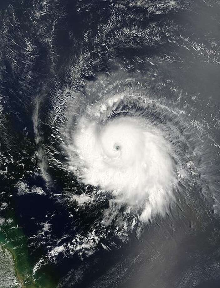 The MODIS instrument aboard NASA's Terra satellite captured this true-color image of Hurricane Ivan on September 5, 2004 at 13:30 UTC (9:30 AM EDT). At the time this image was taken Ivan was located approximately 1670 km (1040 miles) east of the Windward Islands and was moving towards the west near 33 km/hr (21 mph). Ivan had maximum sustained winds near 140 km/hr (85 mph) with higher gusts. The MODIS Rapid Response System provides this image at additional resolutions and formats.