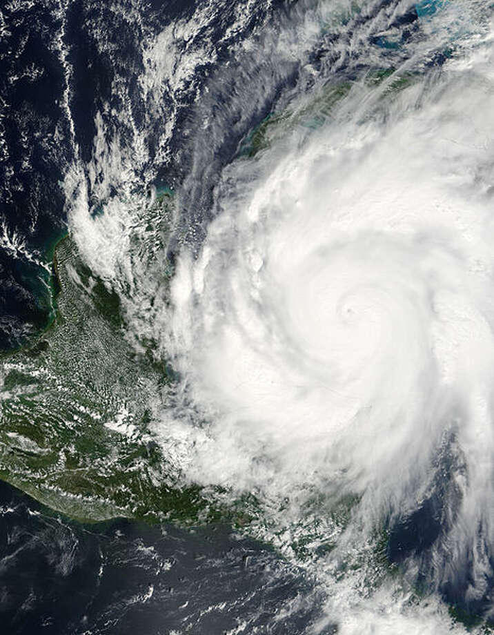 Hurricane Wilma was a powerful Category 5 storm when the Moderate Resolution Imaging Spectroradiometer (MODIS) on NASA's Terra satellite took this image at 12:40 p.m. Eastern Daylight Time, on October 19, 2005. Less than 24 hours before this image was taken, Wilma had rapidly grown into a record-breaking, powerful storm. Winds around the eyewall of the storm were raging at 280 kilometers per hour (175 miles per hour). Just hours before, National Oceanographic and Atmospheric Administration (NOAA) aircraft measured a record-low air pressure of 882 millibars in the center of Hurricane Wilma, making it the most intense hurricane ever observed in the Atlantic basin. Wilma also broke records for the fastest development of a storm, going from tropical storm status to Category 5 hurricane in less than 24 hours. The high-resolution image provided above has a spatial resolution of 250 meters per pixel. The MODIS Rapid Response Team provides this image at additional resolutions. Photo: NASA