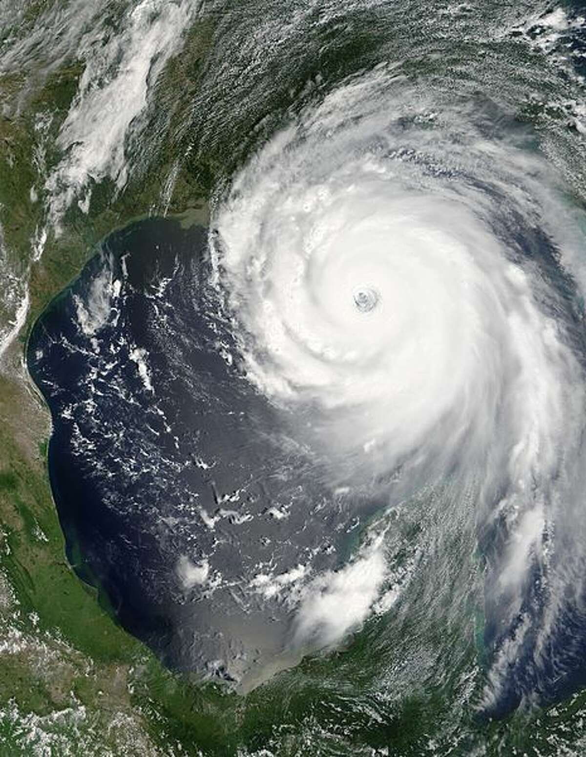Two hours after the National Hurricane Center issued their warning, the Moderate Resolution Imaging Spectroradiometer (MODIS) captured this image from NASA's Terra satellite at 1:00 p.m. Eastern Daylight Savings Time. The massive storm covers much of the Gulf of Mexico, spanning from the U.S. coast to the Yucatan Peninsula.