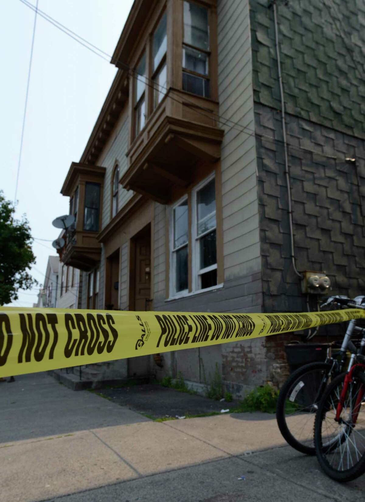 3022 7th Avenue in Troy, N.Y. has been declared a crime scene after a shooting victim was found July 13, 2012. (Skip Dickstein / Times Union)