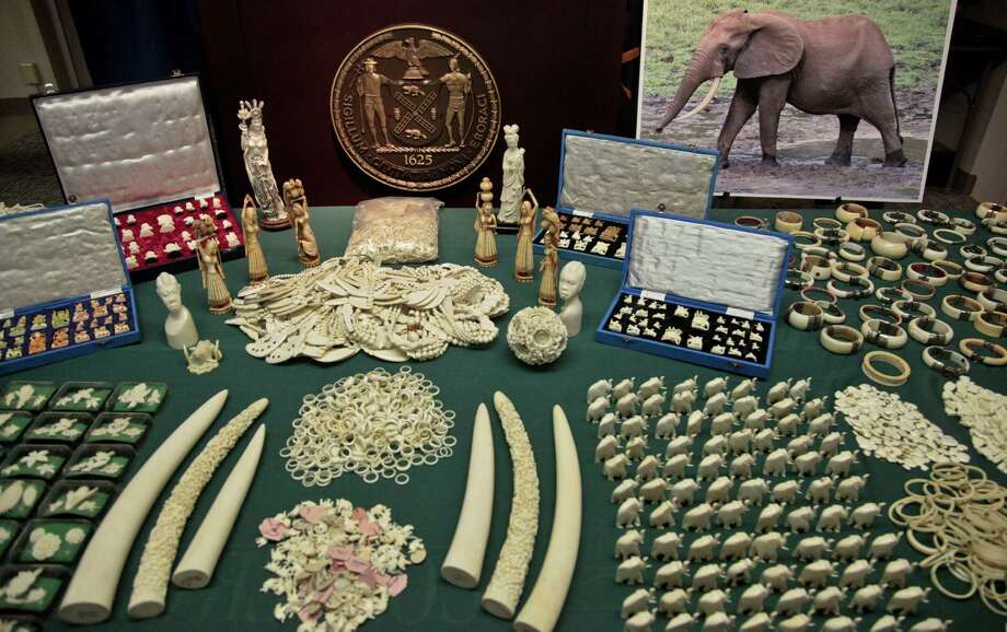 Jewelry and carvings are displayed during a press conference where Manhattan District Attorney Cyrus R. Vance, Jr., announced the guilty pleas of two ivory dealers and their businesses for selling and offering for sale illegal elephant ivory with a retail value of more than $2 million on Thursday, July 12, 2012 in New York. Photo: Bebeto Matthews, AP / AP