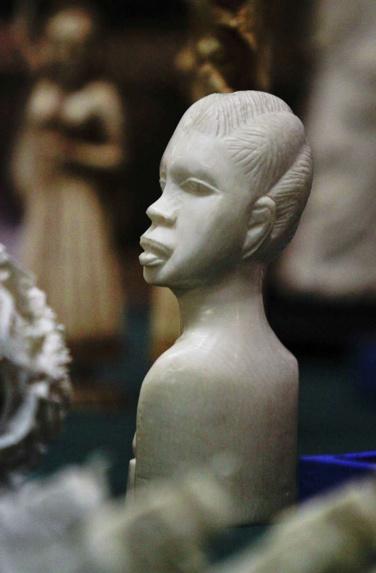 An ivory carving of a head is displayed during a press conference where Manhattan District Attorney Cyrus R. Vance, Jr., announced the guilty pleas of two ivory dealers and their businesses for selling and offering for sale illegal elephant ivory with a retail value of more than $2 million on Thursday, July 12, 2012.