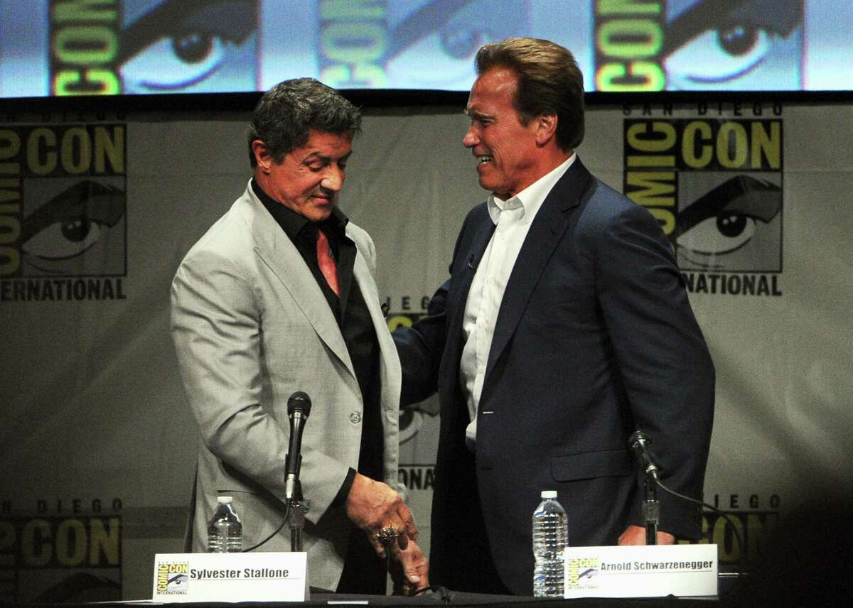 Actors Sylvester Stallone and Arnold Schwarzenegger speak at