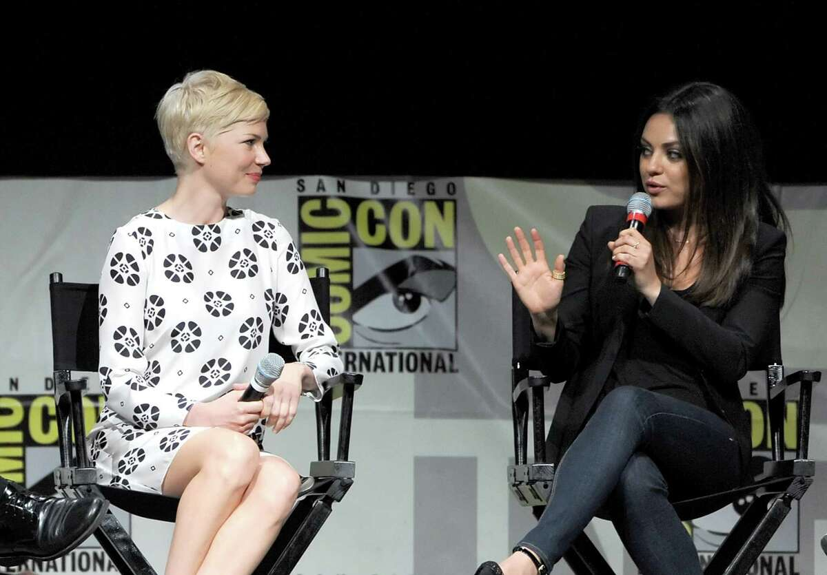 Actresses Michelle Williams (L) and Mila Kunis speak at the