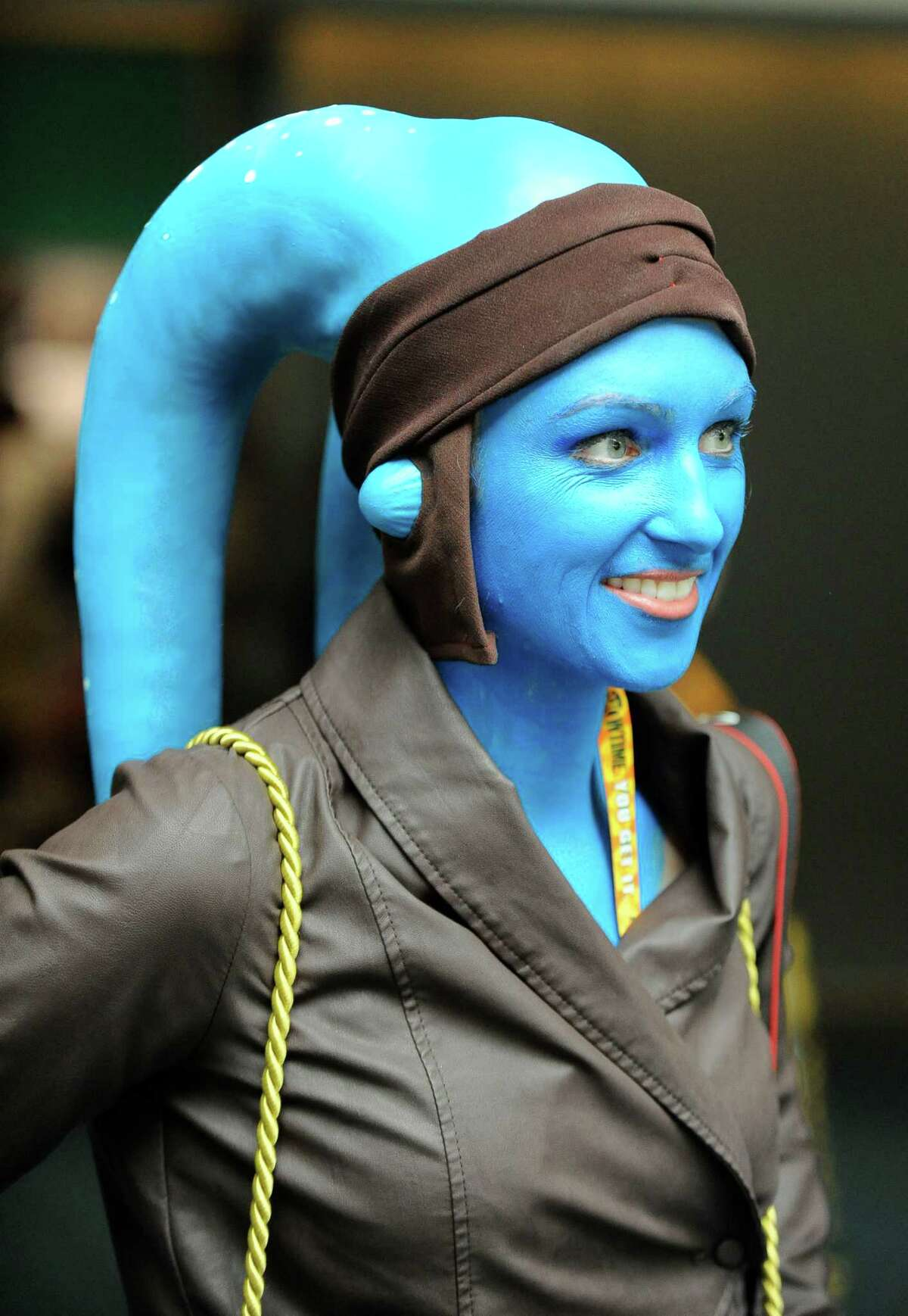 Meghan Spencer, dressed as a Twi'lek from Star Wars movies, walks into the exhibit hall on first day of Comic-Con convention held at the San Diego Convention Center on Thursday July 12, 2012, in San Diego.