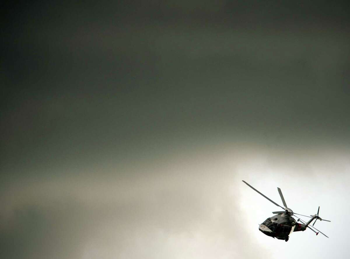 TOPHSOTS An Agusta Westland helicopter flies through a gap in the clouds during a flying display at the third day at the Farnborough International Airshow in Hampshire, southern England, on July 11, 2012. Thousands of industry executives from the worlds of aerospace and defence are gathered at the biennial show. AFP PHOTO / ADRIAN DENNISADRIAN DENNIS/AFP/GettyImages