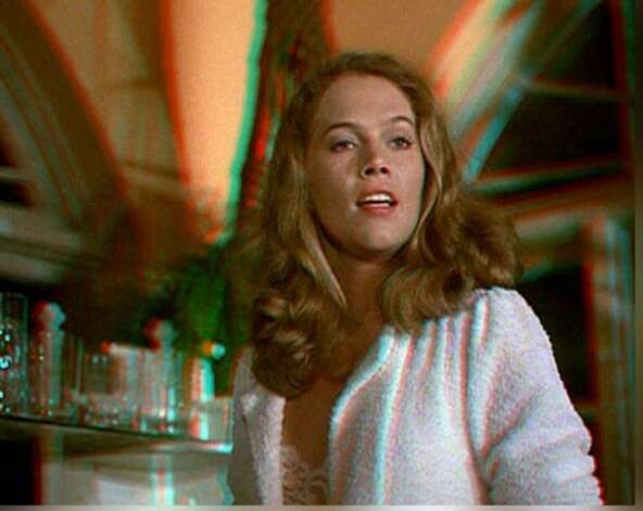 """Body Heat"" -- Kathleen Turner waits to see how crazy she can drive William Hurt and waits for him to break a window. Photo: Warner Bros."