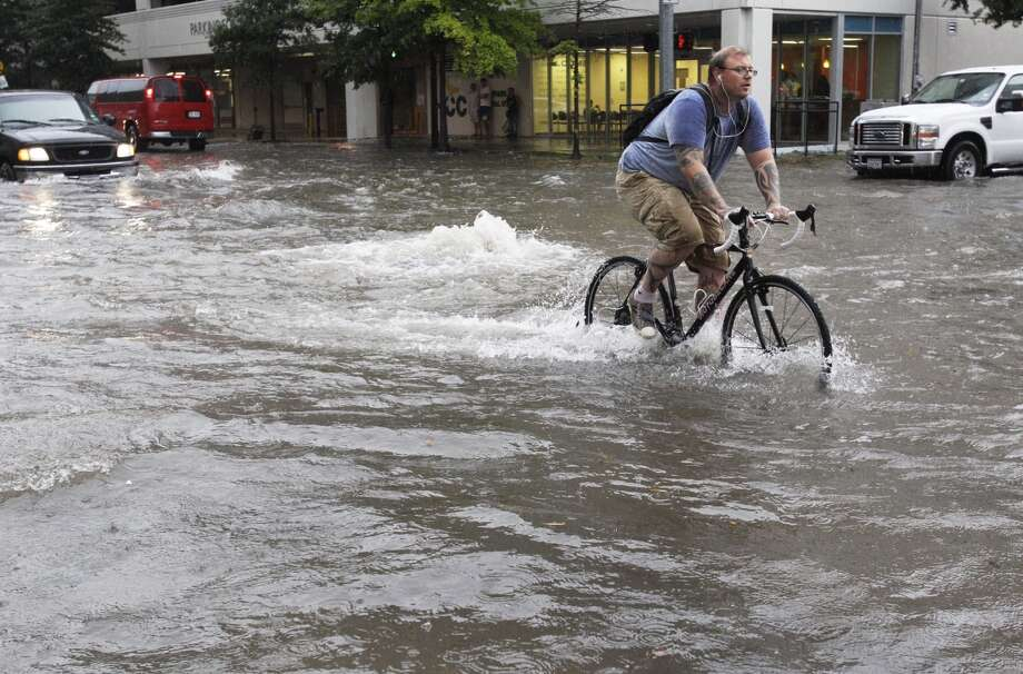 Flooding at the insection of Travis and Elgin Friday, July 13,2012. (Melissa Phillip/Chronicle)