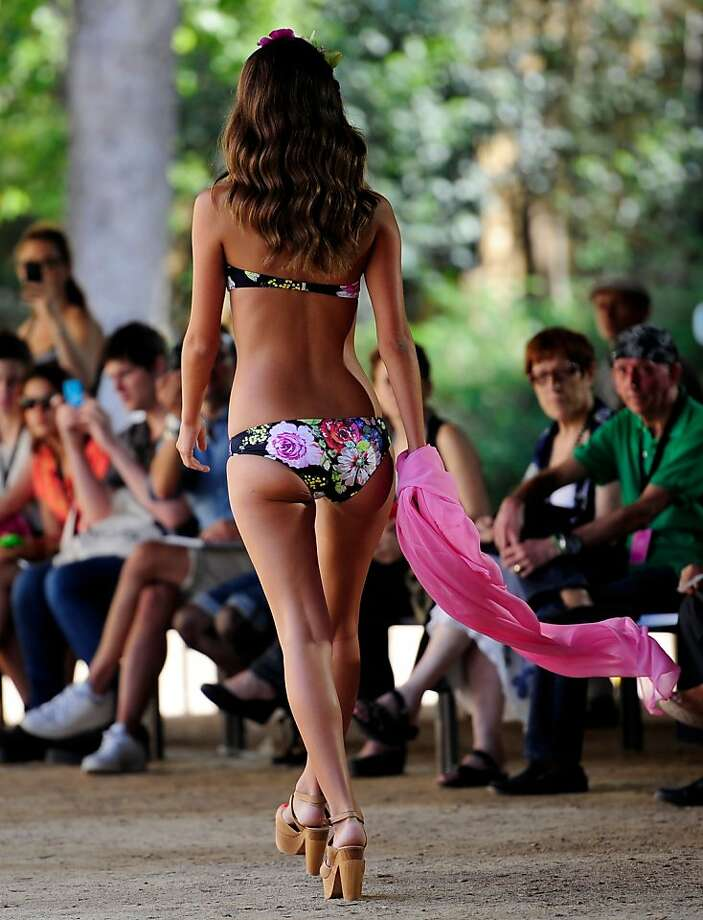 Ready for the beach:A high-heeled model wears a floral creation by Cris Zarel during the 080 Barcelona fashion show. Photo: Manu Fernandez, Associated Press