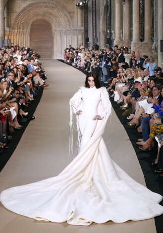 A model presents a creation by French designer Stephane Rolland during the Haute Couture Fall-Winter 2012-2013 collections shows on July 3, 2012 in Paris. AFP PHOTO / PIERRE VERDY        (Photo credit should read PIERRE VERDY/AFP/GettyImages) Photo: PIERRE VERDY, Getty Images / 2012 AFP