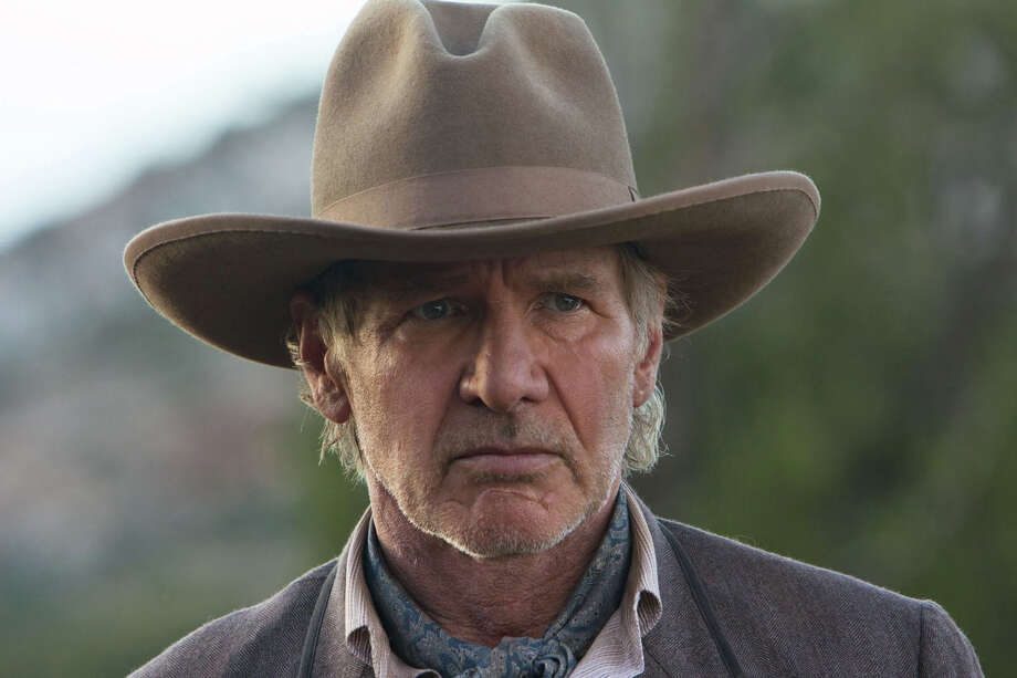 """Harrison Ford turned 70 on Friday. He's still going strong, including this role as Col. Woodrow Dolarhyde in 2011's """"Cowboys and Aliens."""" Click on to see some photos from earlier in his career, followed by other then-and-now pictures of leading men who are now over 70. Photo: Zade Rosenthal, 2011 Universal Studios"""