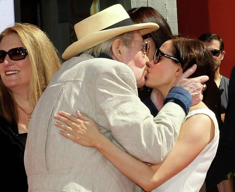 HOLLYWOOD, CA - APRIL 30: Actor Peter O'Toole (L) and actress Rose McGowen kiss during a Hand and Footprints Ceremony presented by the TCM Classic Film Festival at Grauman's Chinese Theater on April 30, 2011 in Hollywood, California.  (Photo by Frederick M. Brown/Getty Images) *** Local Caption *** Peter O'Toole;Rose McGowen; Photo: Frederick M. Brown / Getty Images North America