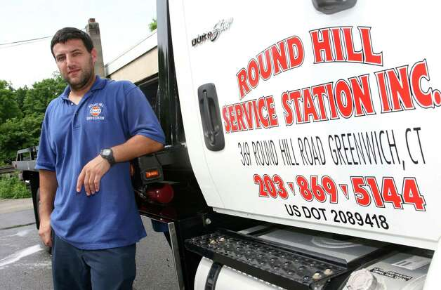 "Round Hill Service Station Inc. towing manager Matthew Swift, seen here Friday, July 13, 2012, says his company is losing business to Stamford-based towing companies that tow vehicles in Greenwich and are allowed to lease the ""rotation"" spots of Greenwich-based towing companies. Photo: David Ames / Greenwich Time"