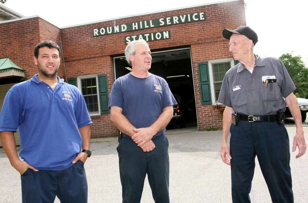 "Round Hill Service Station Inc. towing manager Matthew Swift, left, seen here Friday, July 13, 2012, along with shop manager Jon Wood, center and owner Bill Strain, right, says his company is losing business to Stamford-based towing companies that tow vehicles in Greenwich and are allowed to lease the ""rotation"" spots of Greenwich-based towing companies. Photo: David Ames / Greenwich Time"