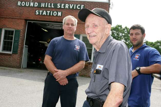 "Round Hill Service Station Inc. towing manager Matthew Swift, right, seen here Friday, July 13, 2012, along with owner Bill Sprain, center, and shop manager Jon Wood, left, says his company is losing business to Stamford-based towing companies that tow vehicles in Greenwich and are allowed to lease the ""rotation"" spots of Greenwich-based towing companies. Photo: David Ames / Greenwich Time"