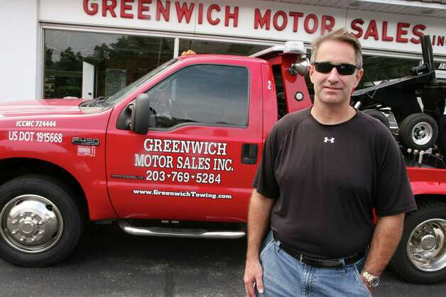 "Steve Peterson towing manager of Greenwich Motor Sales, seen here Friday, July 13, 2012, says his company is losing business to Stamford-based towing companies that tow vehicles in Greenwich and are allowed to lease the ""rotation"" spots of Greenwich-based towing companies. Photo: David Ames / Greenwich Time"