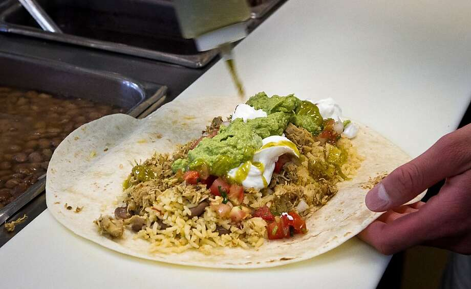 A Chicken Super Deluxe Burrito being made by Aldo Hernandez at Puentez Taqueria  in San Rafael, Calif., on Monday, July 9th, 2012. Photo: John Storey, Special To The Chronicle