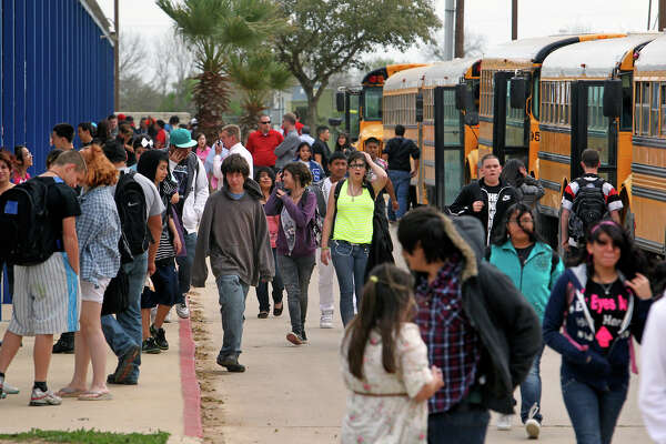 METRO   Crowds of students head for buses at the high school as Somerset Independent School District deals with funding issues on March 6, 2012 Tom Reel/ San Antonio Express-News