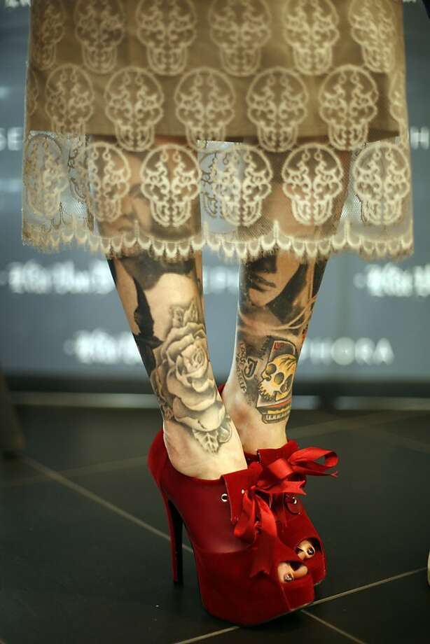 Kat Von D shows off her tatooed legs at a show of here artwork in Portland, Ore. (Photo by Jackie Butler/Getty Images for Sephora) Photo: Jackie Butler, Getty Images For Sephora