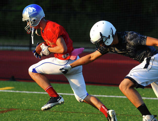 Bunnell's Jared Vasqeuz completes a pass at Fairfield County All-Star football practice at St. Joseph High School in Trumbull, Conn. on Thursday July 12, 2012. Photo: Christian Abraham / Connecticut Post