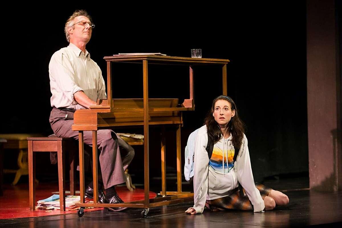 "Pops (Dan Hiatt, left) plays and budding pianist Kiddo (Renata Friedman) listens in TheatreWorks' world premeire of Laura Schellhardt's ""Upright Grand"""