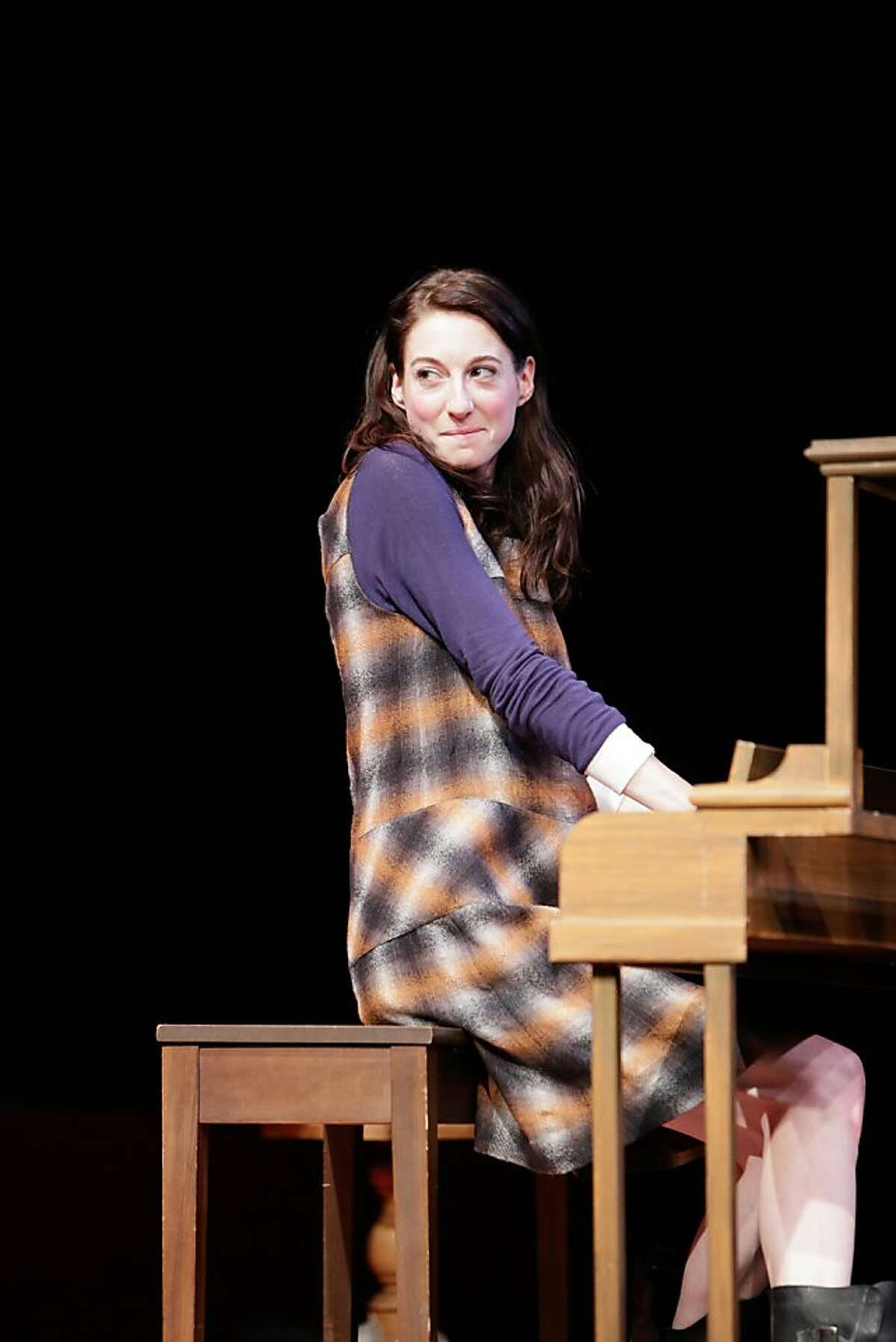 """Kiddo (Renata Friedman) begins to outshine her father at the piano in TheatreWorks' world premeire of Laura Schellhardt's """"Upright Grand"""""""