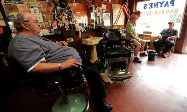 David Payne chats with Bill Burleson and Newal Yarbrough at Payne's Barber Shop in Sour Lake, Wednesday, July 11, 2012. Tammy McKinley/The Enterprise Photo: TAMMY MCKINLEY