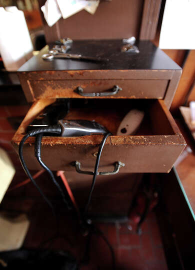 Clippers hang in an antique chest of drawers at Payne's Barber Shop in Sour Lake, Wednesday, July 11