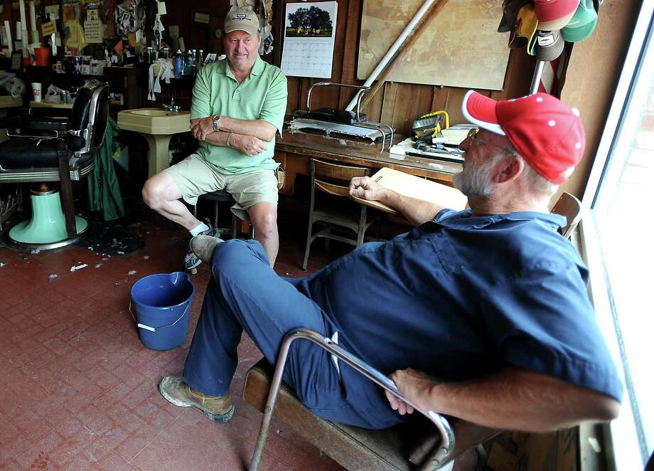 Bill Burleson and Newal Yarbrough hang out and chat at Payne's Barber Shop in Sour Lake, Wednesday, July 11, 2012. Tammy McKinley/The Enterprise Photo: TAMMY MCKINLEY