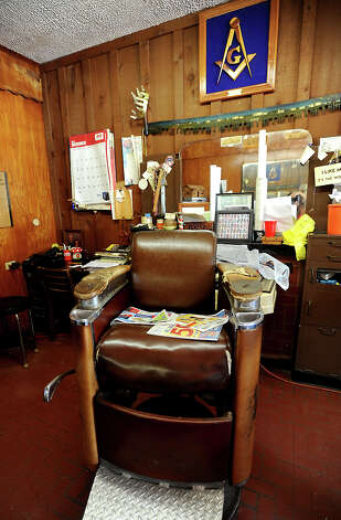 David Payne's barber shop is filled with items from decades of work in the same location in Sour Lake, Wednesday, July 11, 2012. Tammy McKinley/The Enterprise Photo: TAMMY MCKINLEY