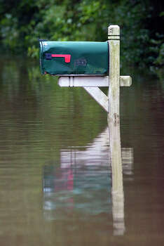 A mailbox is seen on the flooded street of Pine Belt Drive Friday, July 13, 2012, in Cypress. Photo: Cody Duty, Houston Chronicle / © 2011 Houston Chronicle