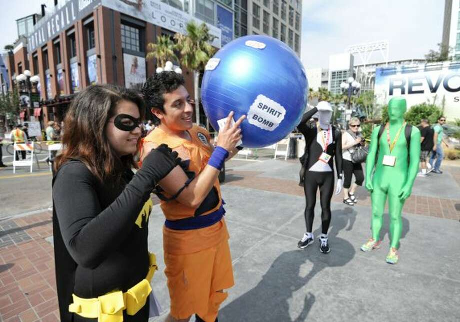 Comic-Con fans walk on Fifth Avenue near the San Diego Convention Center before preview night at Comic - Con on Wednesday July 11, 2012, in San Diego.  (Photo by Denis Poroy/Invision/AP) (DENIS POROY/INVISION/AP)