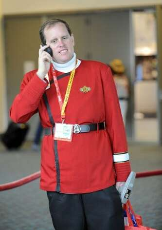 Matthew Hunter, dressed as Star Trek's Captain Kirk, makes a call as he waits to set-up his exhibit on preview night at Comic-Con held at the San Diego Convention Center on Wednesday July 11, 2012, in San Diego.  (Photo by Denis Poroy/Invision/AP) (DENIS POROY/INVISION/AP)