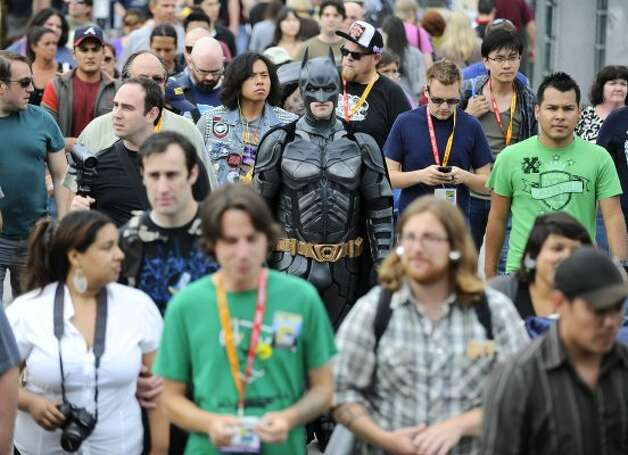 Fans walk to preview night at Comic-Con held at the San Diego Convention Center on Wednesday July 11, 2012, in San Diego.  (Photo by Denis Poroy/Invision/AP) (DENIS POROY/INVISION/AP)