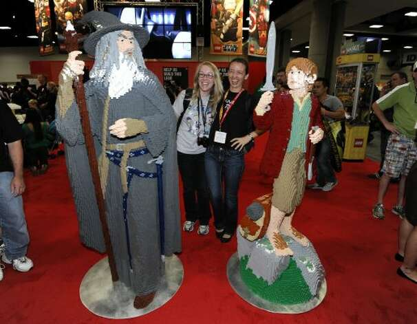 Fans pose with life-sized LEGO Lord of the Rings figures at Comic-Con preview night held at the San Diego Convention Center on Wednesday July 11, 2012, in San Diego.  (Photo by Denis Poroy/Invision/AP) (DENIS POROY/INVISION/AP)