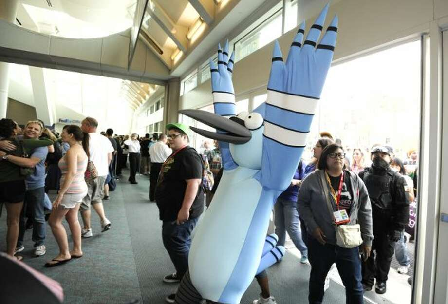 A fan dressed as a cartoon character celebrates as the doors open at Comic-Con preview night held at the San Diego Convention Center on Wednesday July 11, 2012, in San Diego.  (Photo by Denis Poroy/Invision/AP) (DENIS POROY/INVISION/AP)