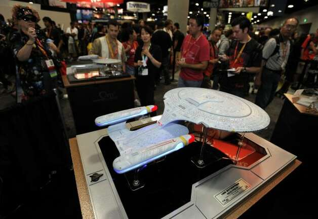 Fans look over a Quantum Mechanix replica of the Star Trek ship the USS Enterprise at the Comic-Con preview night held at the San Diego Convention Center on Wednesday July 11, 2012, in San Diego.  (Photo by Denis Poroy/Invision/AP) (DENIS POROY/INVISION/AP)