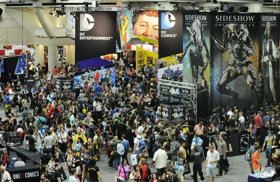 Thousands of fans walk through the exhibit hall on preview night at Comic-Con on at the San Diego Convention center Wednesday July 11, 2012, in San Diego.  (Photo by Denis Poroy/Invision/AP) (DENIS POROY/INVISION/AP)