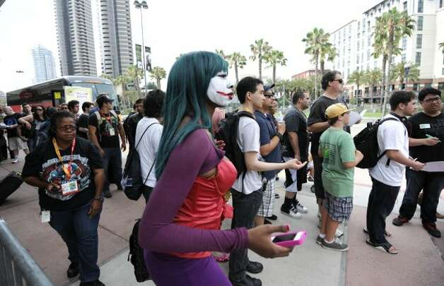 Fans arrive at the San Diego Convention Center before preview night at Comic - Con on Wednesday July 11, 2012, in San Diego.  (Photo by Denis Poroy/Invision/AP) (DENIS POROY/INVISION/AP)
