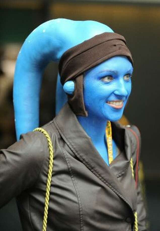 Meghan Spencer, dressed as a Twi'lek from Star Wars movies, walks into the exhibit hall on first day of Comic-Con convention held at the San Diego Convention Center on Thursday July 12, 2012, in San Diego. (Photo by Denis Poroy/Invision/AP) (DENIS POROY/INVISION/AP)