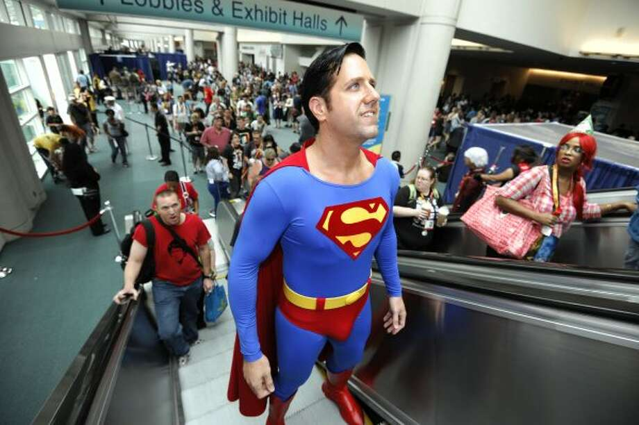 Trey Moore, dressed as Superman, rides the escalator on first day of Comic-Con convention held at the San Diego Convention Center on Thursday July 12, 2012, in San Diego.  (Photo by Denis Poroy/Invision/AP) (DENIS POROY/INVISION/AP)