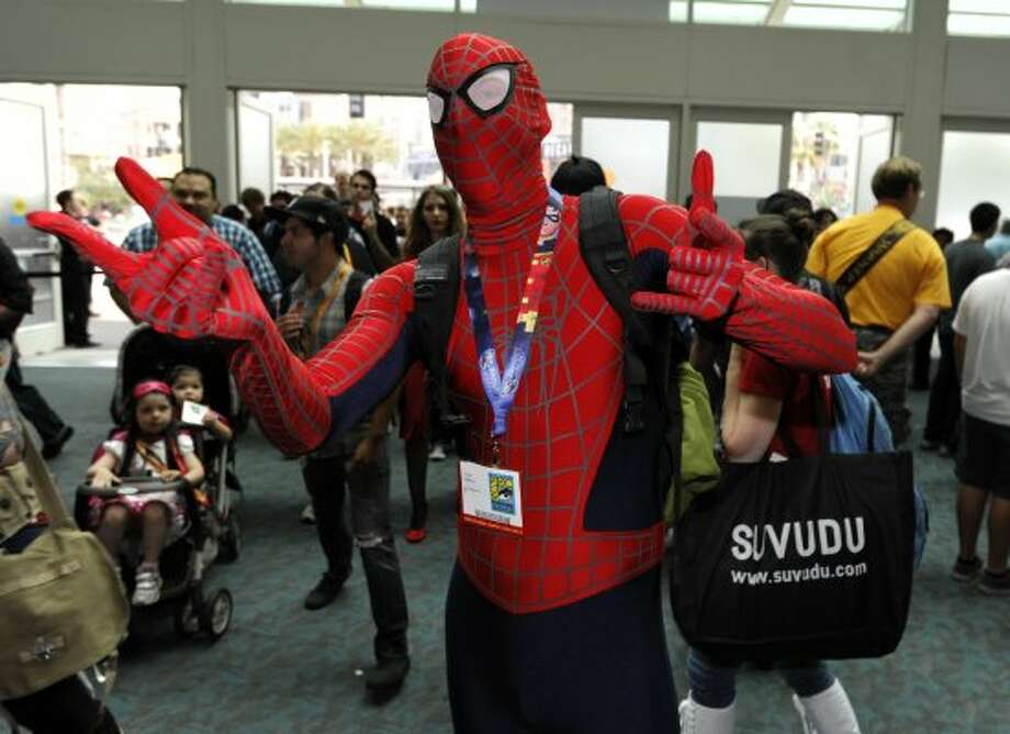 Taylor Roszkos, dressed as Spider Man, comes through the doors on first day of Comic-Con convention held at the San Diego Convention Center on Thursday July 12, 2012, in San Diego.  (Photo by Denis Poroy/Invision/AP) (DENIS POROY/INVISION/AP)