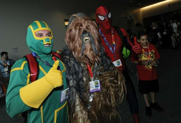 Characters pose photos on first day of Comic-Con convention held at the San Diego Convention Center on Thursday July 12, 2012, in San Diego.  (Photo by Denis Poroy/Invision/AP) (DENIS POROY/INVISION/AP)